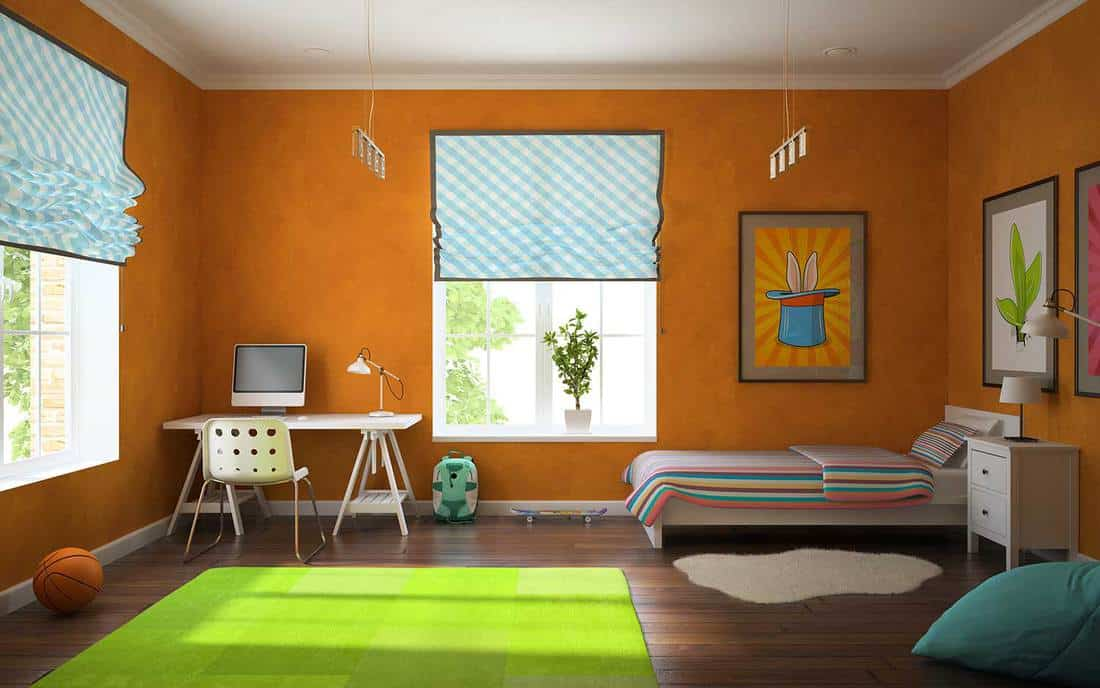 Part of interior modern childroom with orange walls
