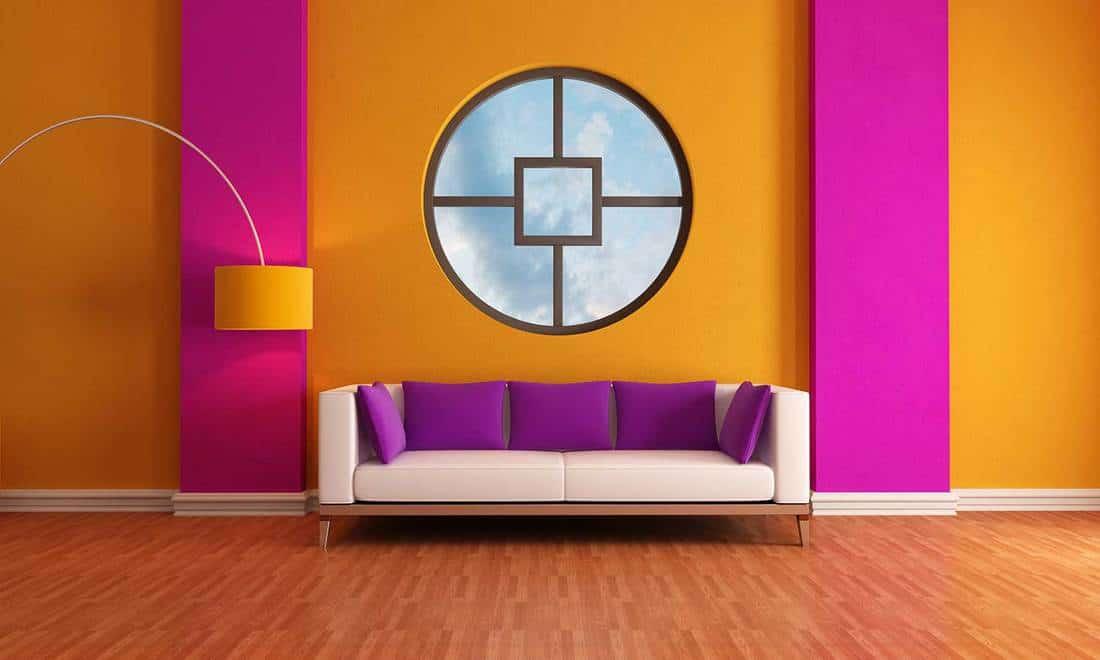 Purple and orange lounge with yellow lamp