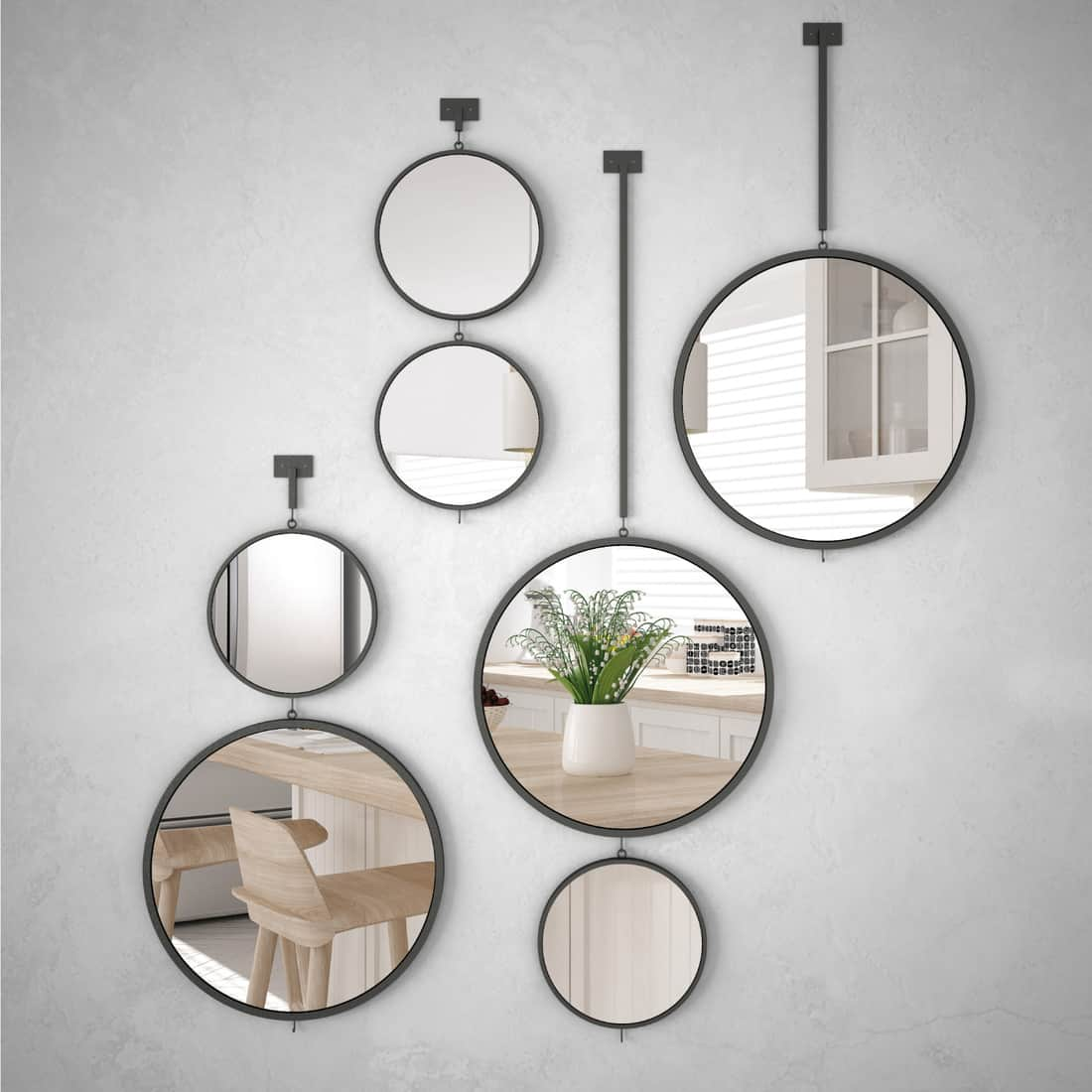 Round mirrors hanging on the wall reflecting interior design scene