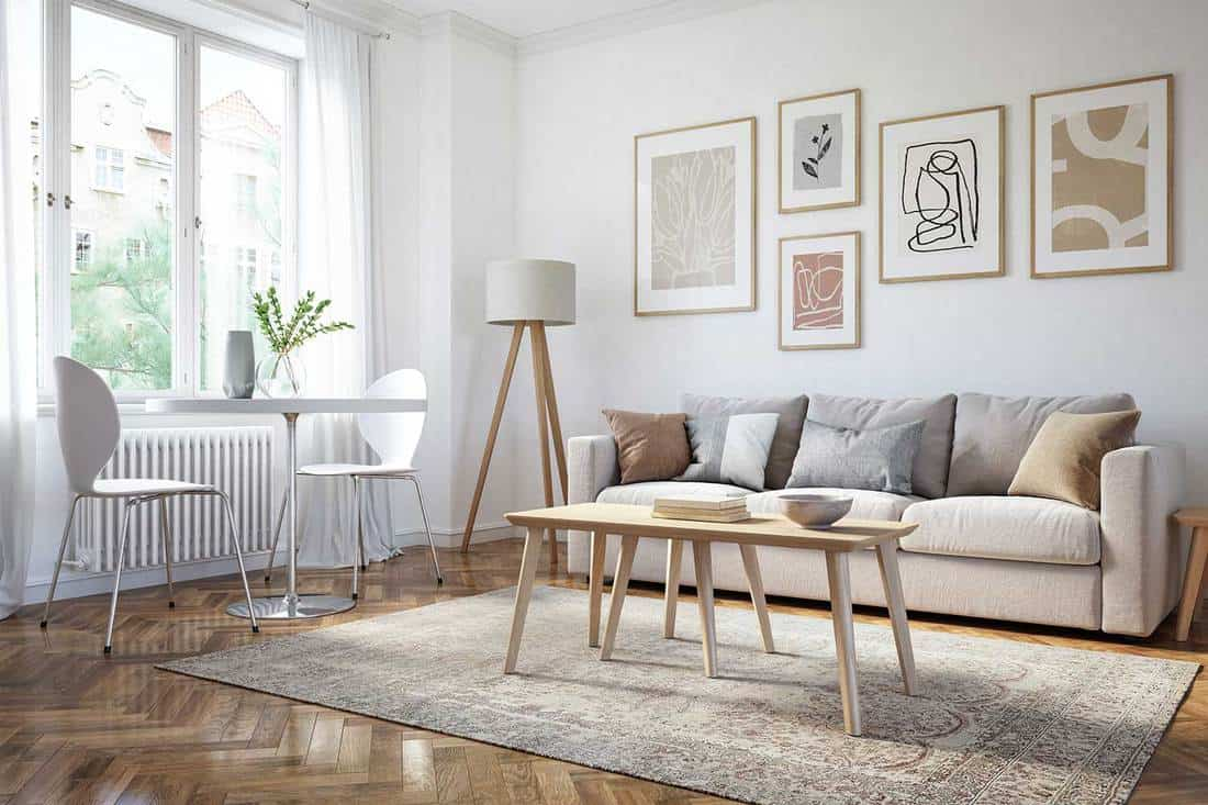 Scandinavian interior design living room with framed artwork on wall and wooden elements