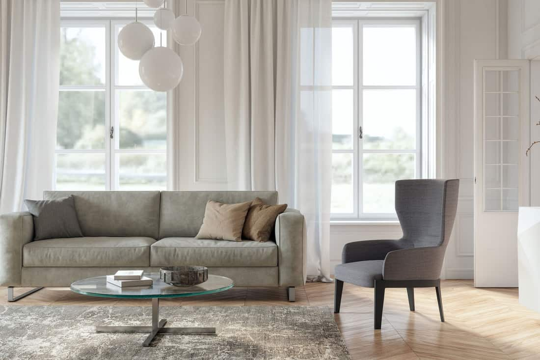 Scandinavian interior design living room with gray and beige colored furniture and wooden elements