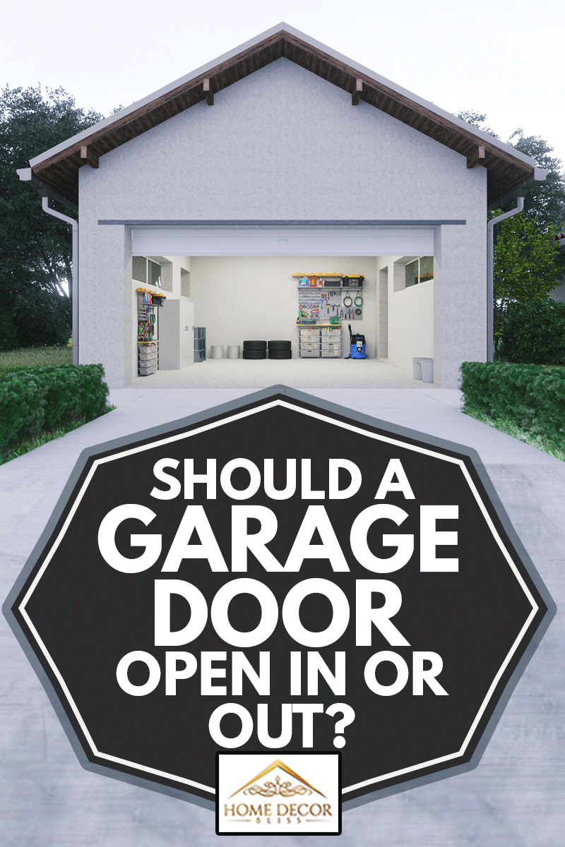 Open door of a modern garage with a concrete driveway at the urban district, Should A Garage Door Open In Or Out?