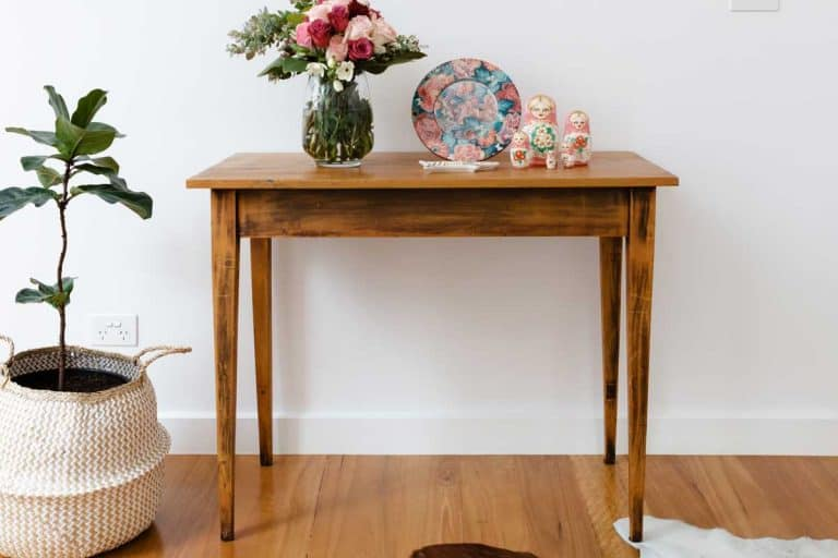 Side table with flowers and pot plant, 13 Types Of Table Legs To Know
