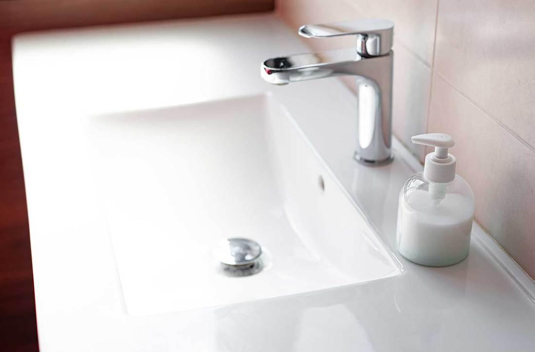 Sink soap dispenser on modern bathroom