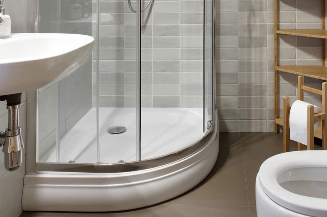 Small bathroom with toilet and shower in gray tones, How To Clean Shower Base With Baking Soda [6 Simple Steps]