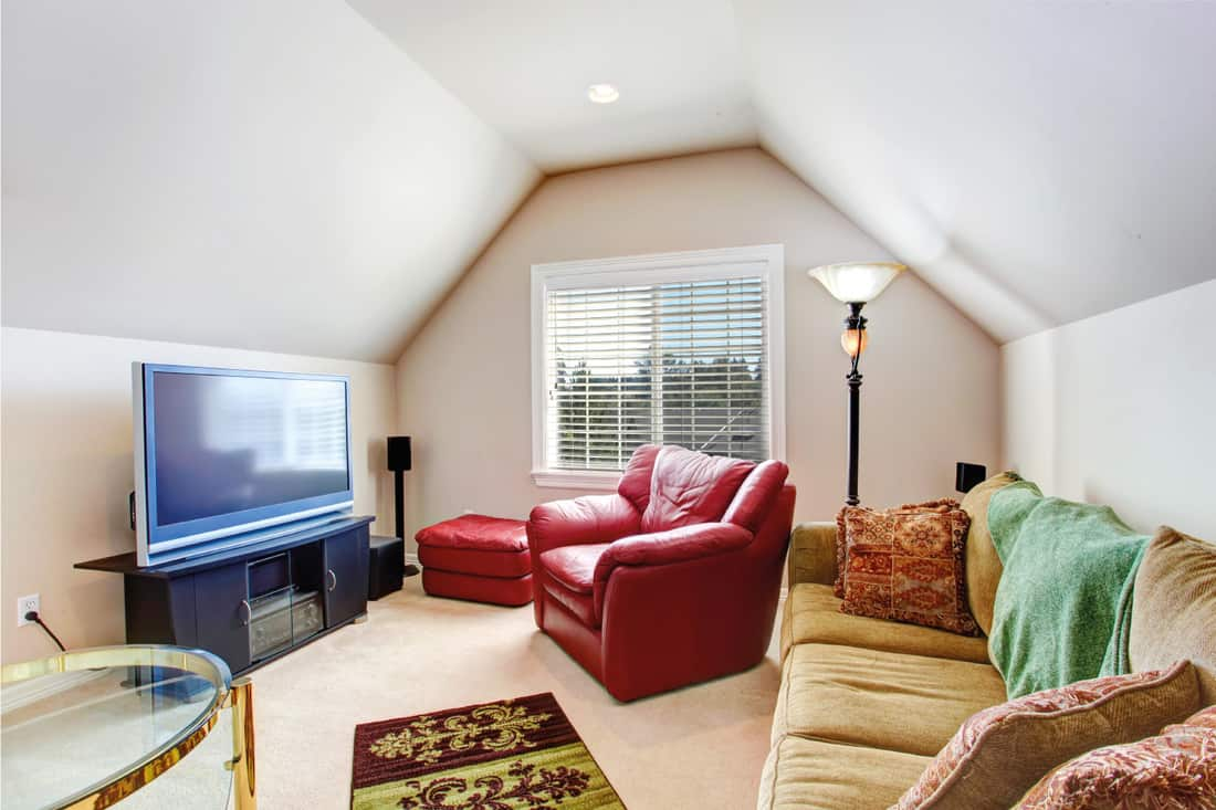 Small living room with red armchair and TV