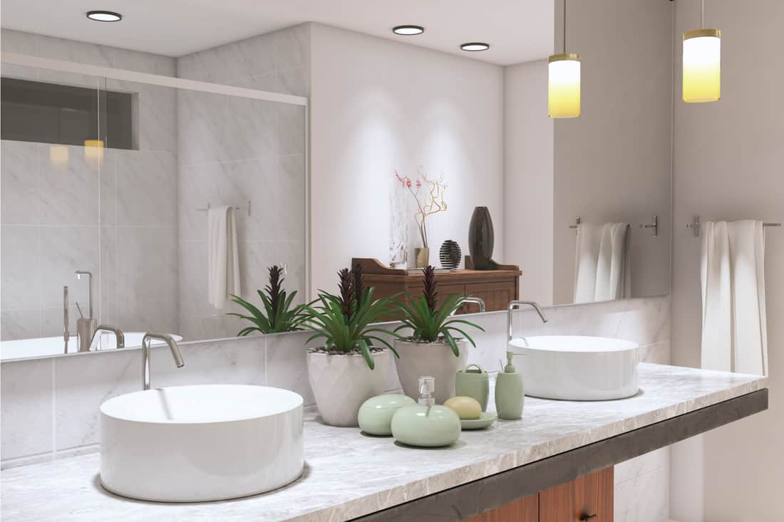 Soft White Modern Bathroom with white sink large mirror and plants