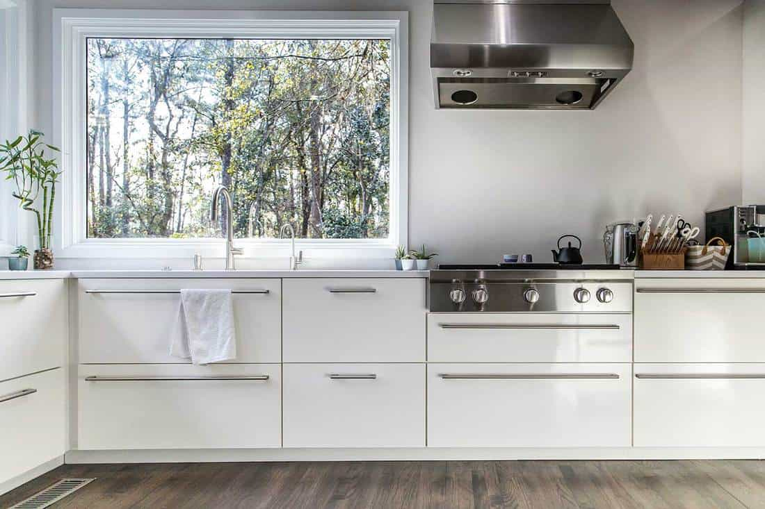 Spacious large modern contemporary recently renovated white kitchen recently updated with high-end appliances, hardwood floors and white cabinets