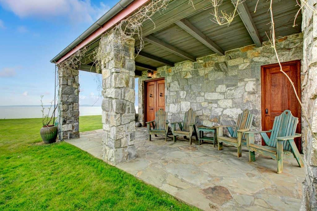 Spacious open porch with stone walls