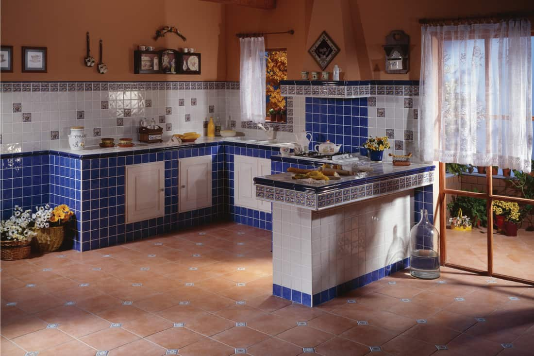 Spanish style country kitchen. Cottage kitchen made up of ceramic tiles