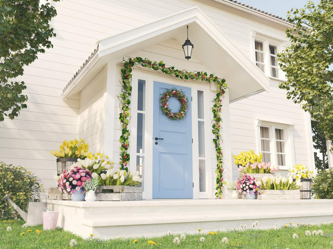 Spring decorated porch with a lot of flowers