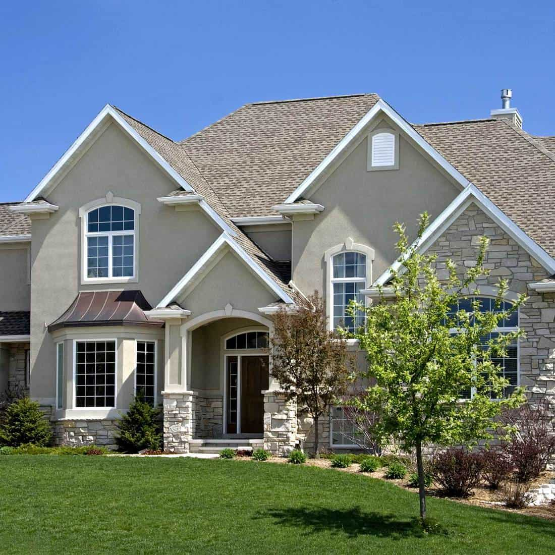 Suburban home with front yard and tile roof