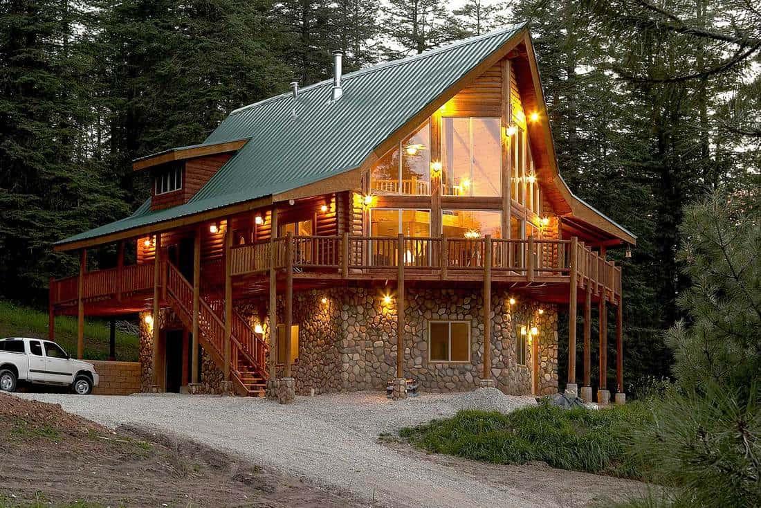 Summer forest cabin at dusk