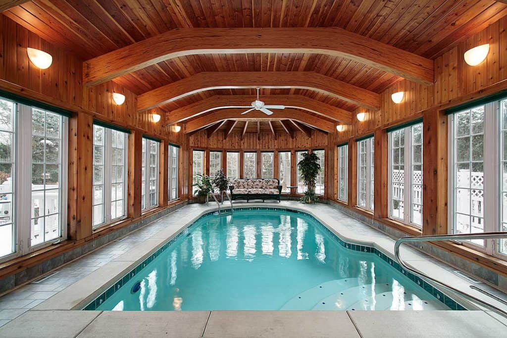Swimming pool with wood ceiling beams
