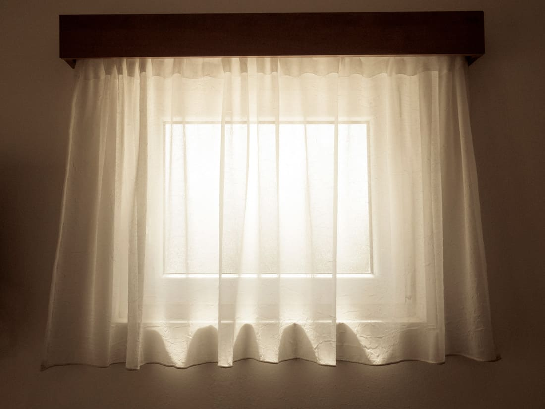 Translucent Sheer Curtains covering a small window
