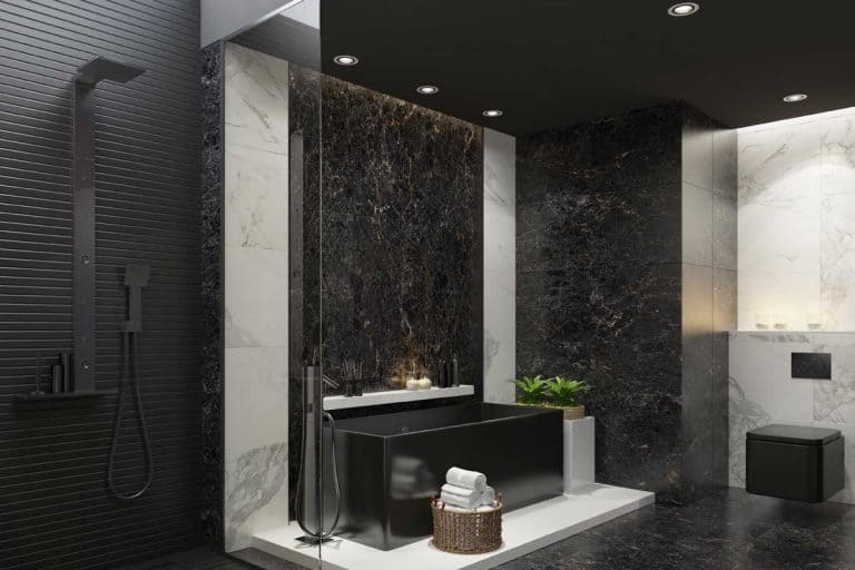 Trendy and modern home spa bathroom with matte black and white marble tiles, black stone wall in bath and stove light, Black Bathroom Fixtures Advantages And Disadvantages