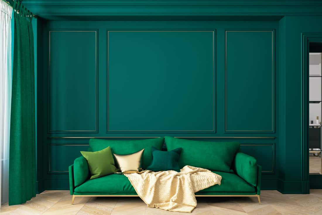 Living room interior with various shades of green with gold accents
