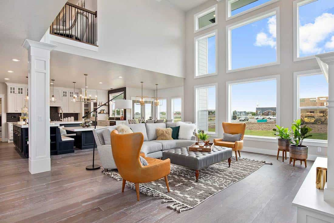 Vinyl waterproof flooring in two story open great room with tall windows