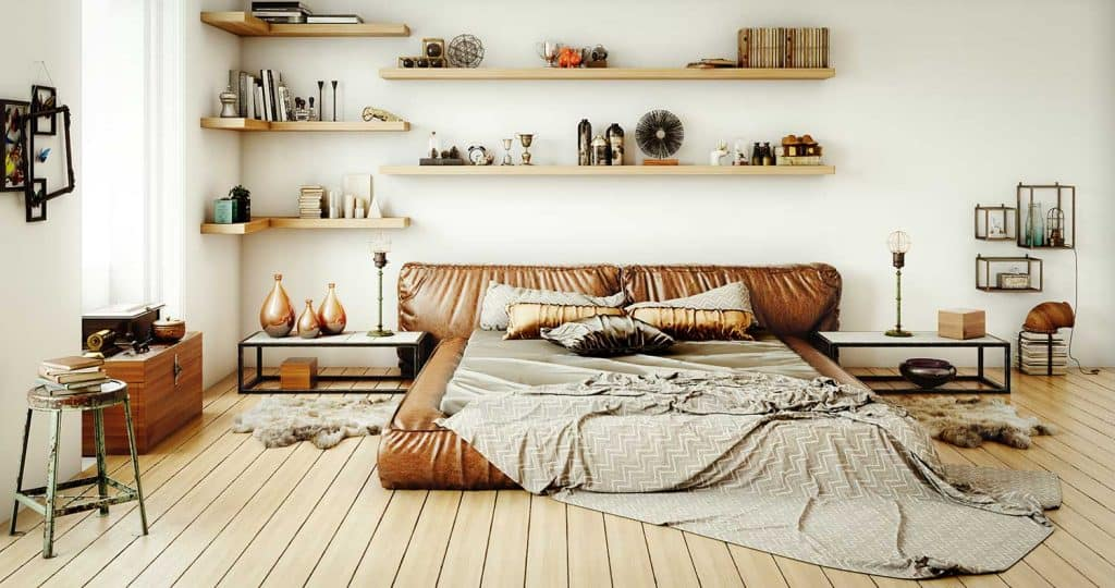 Warm and cozy home bedroom interior with brown leather bed and hardwood floor