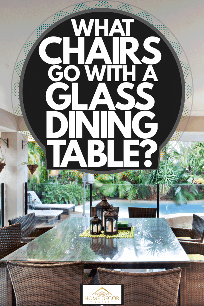A glass dining table with weaved chairs outside a luxurious mansion, What Chairs Go With A Glass Dining Table?