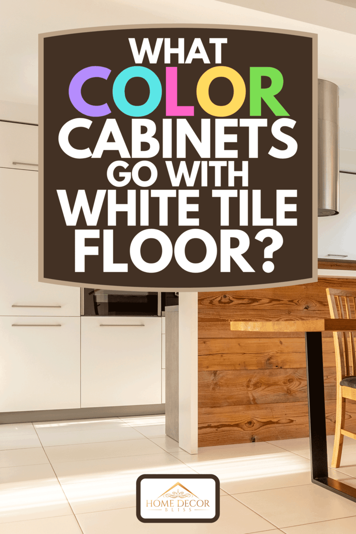 A spacious, open kitchen and dining room with wooden table and chairs, large window, white cupboards and tiles on the floor, What Color Cabinets Go With White Tile Floor?