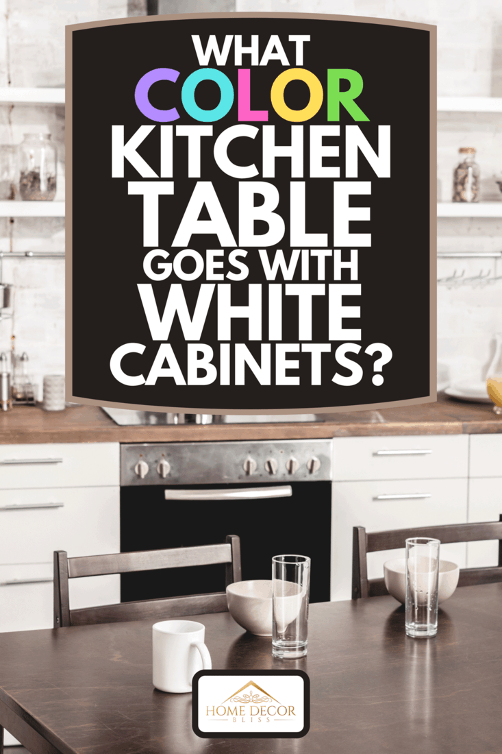 Modern kitchen interior with white cabinets and table ready for breakfast, What Color Kitchen Table Goes With White Cabinets?
