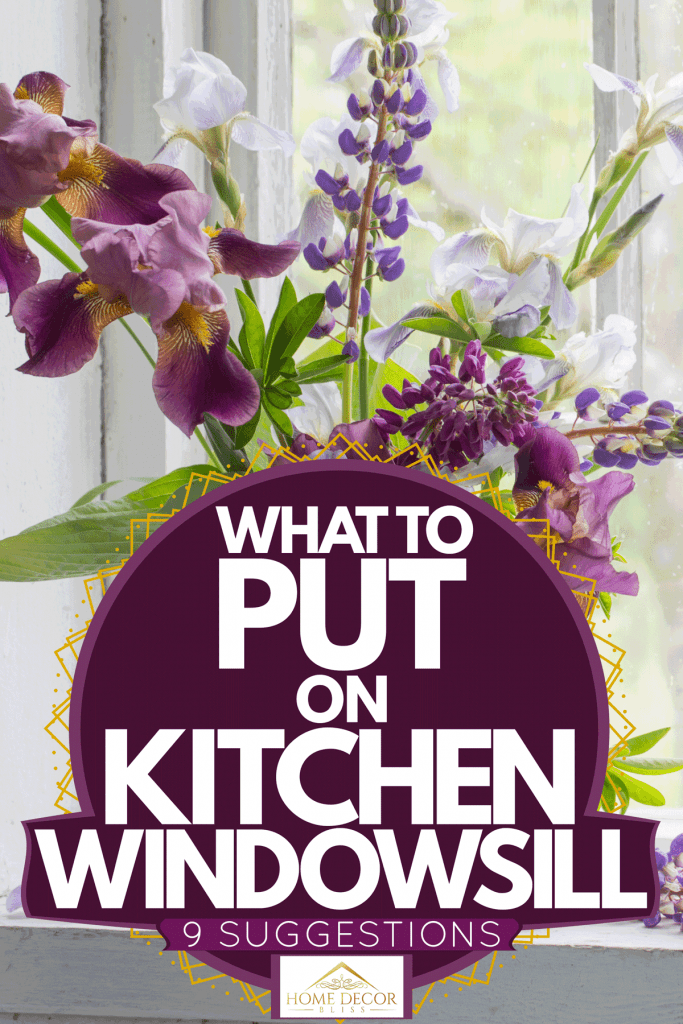 A gorgeous collection of flowers and orchids on a white vase placed on a windowsill, What To Put On Kitchen Windowsill [9 Suggestions]