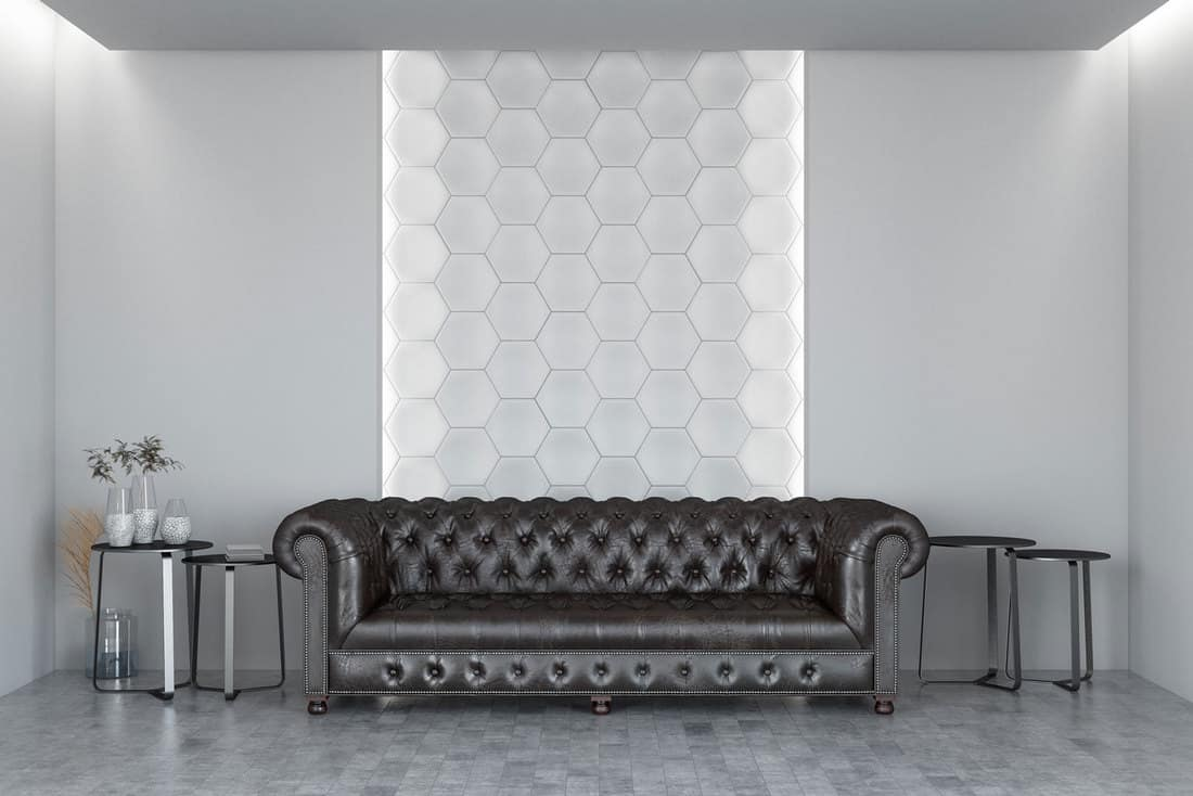 White Room with Hexagonal Wall and Chesterfield Sofa
