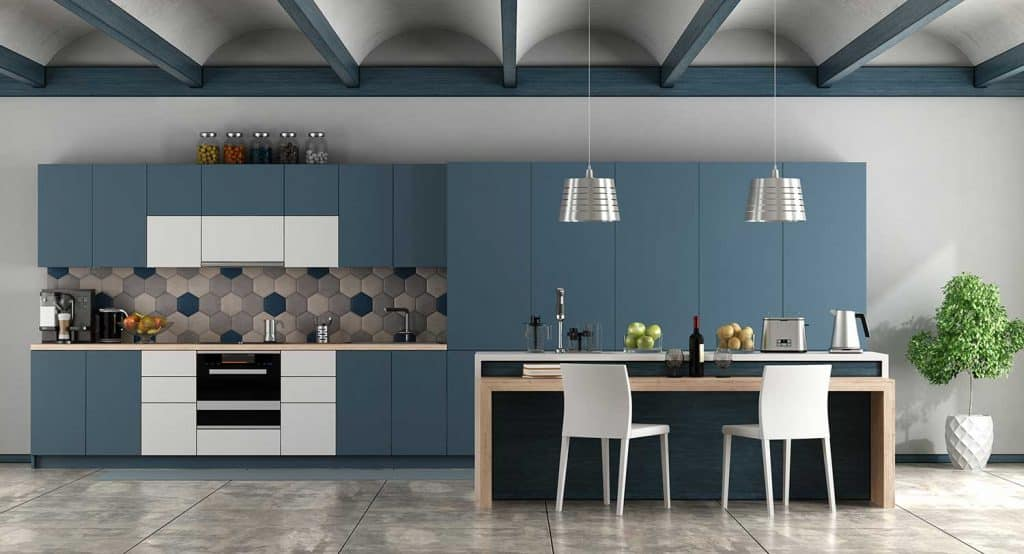 White and blue contemporary kitchen with arched ceiling and cement floor