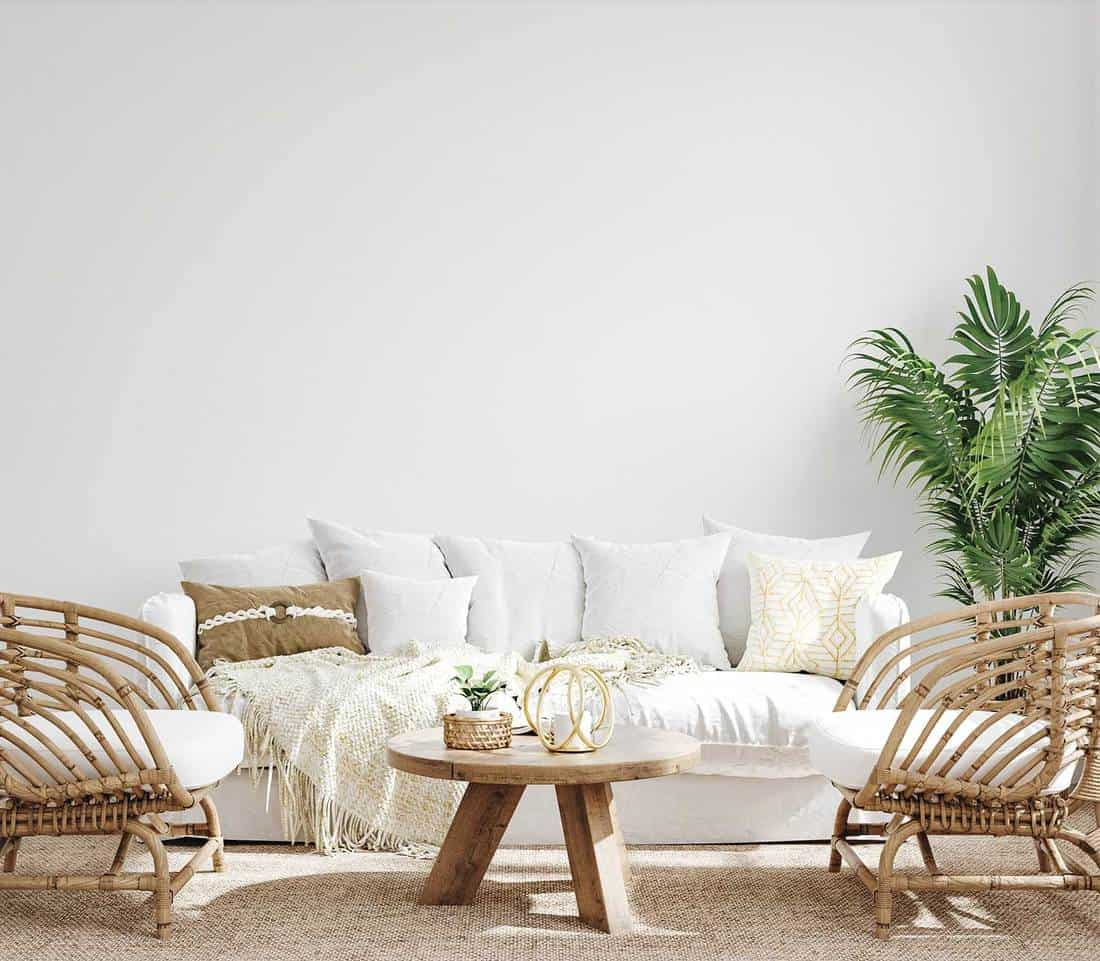 White cozy living room interior in coastal boho style