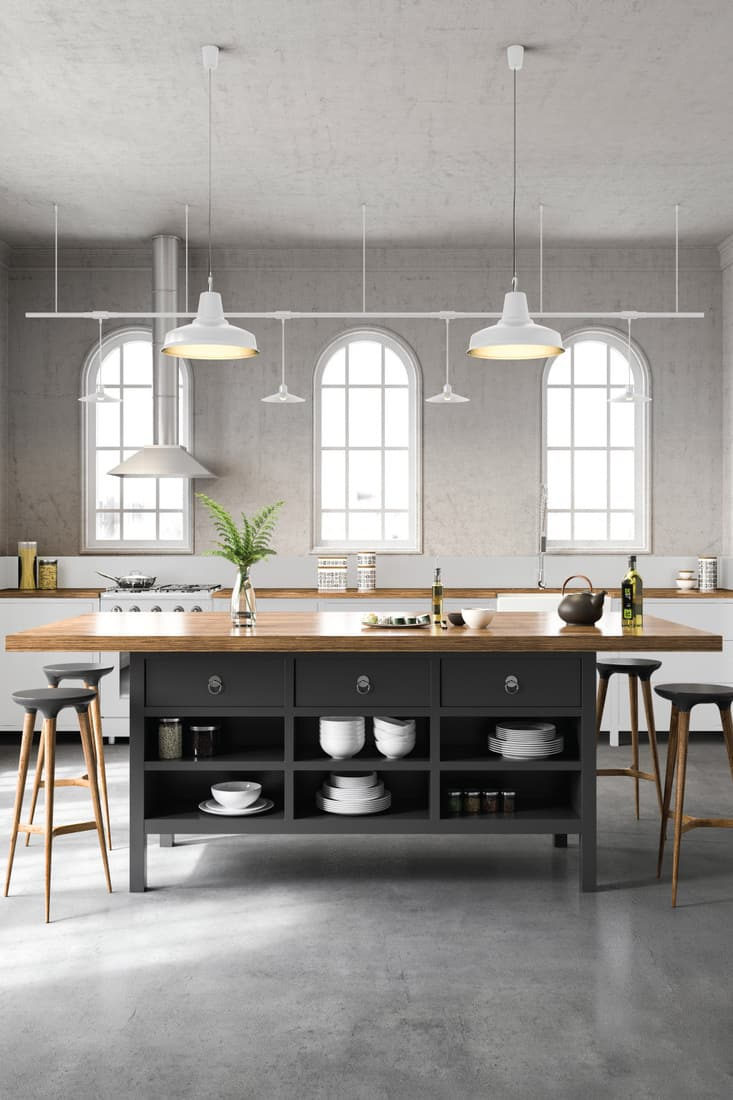 Black and white industrial kitchen interior with island, pendant lights, gray floor