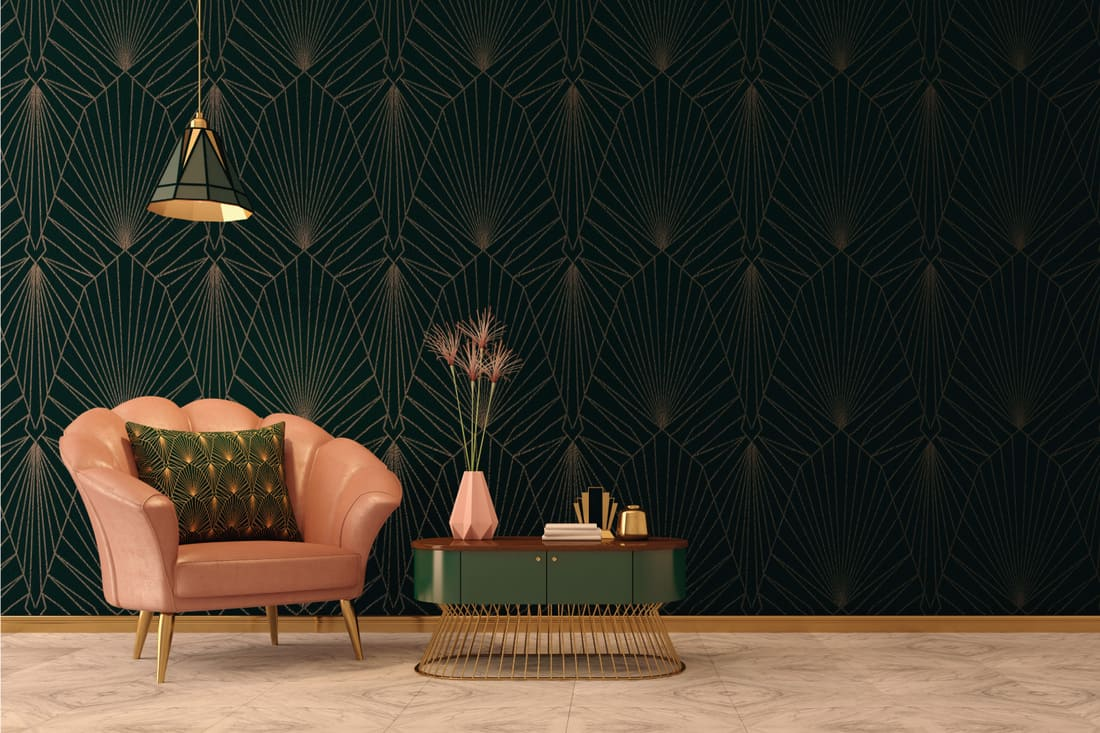 Classic style living room with pink armchair and pillow, vase on table, dark green wall and ceiling lamp