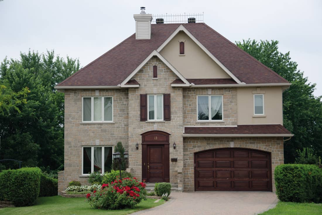 Dream house luxury mansion with matching brown front door and garage door