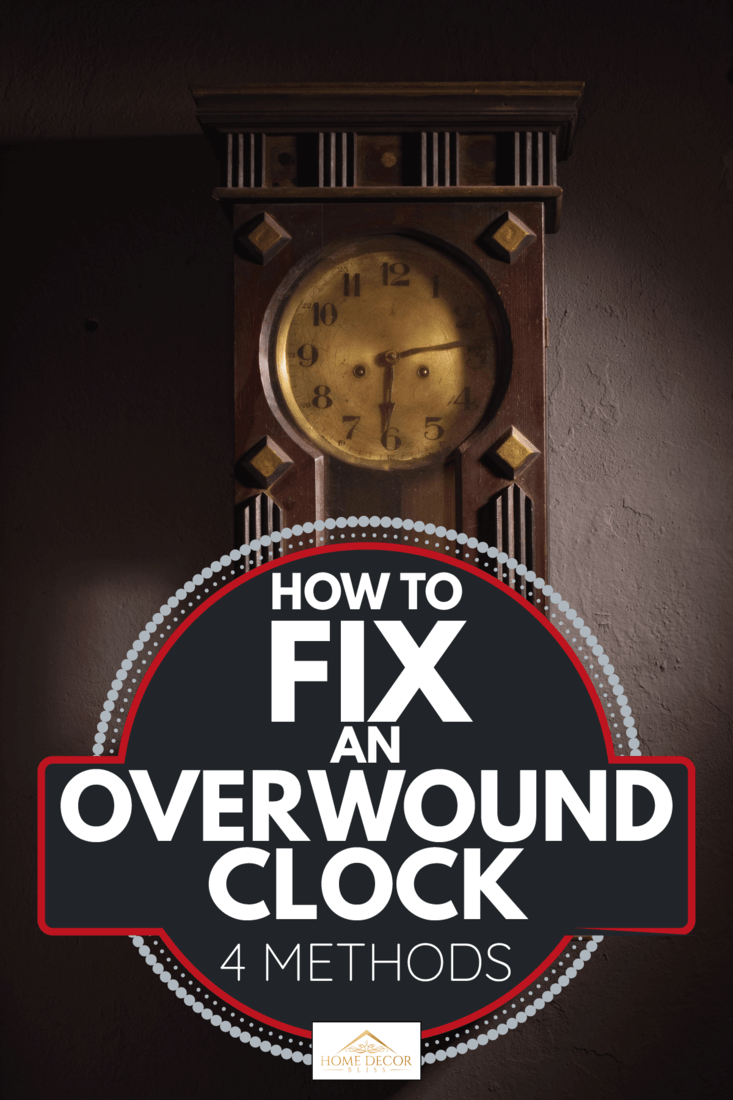 grandfather clock hanging on a wall in a dark room. How To Fix An Overwound Clock [4 Methods]
