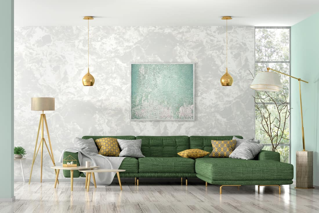 Green corner sofa, coffee tables and floor lamp in a modern living room