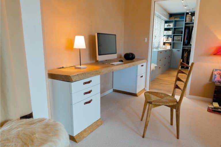 home personal office with natural oak trim on desk, oak chair, cream-colored carpet. What Color Flooring Goes With Oak Trim