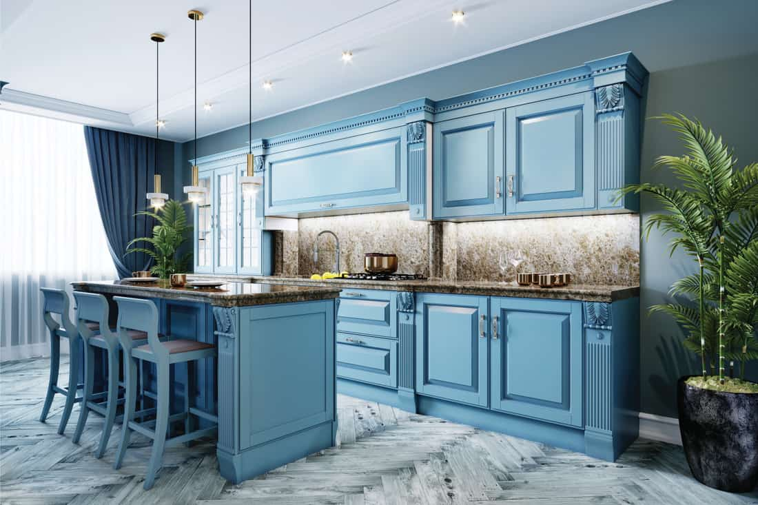 Kitchen with blue walls and blue furniture, cool toned gray floor