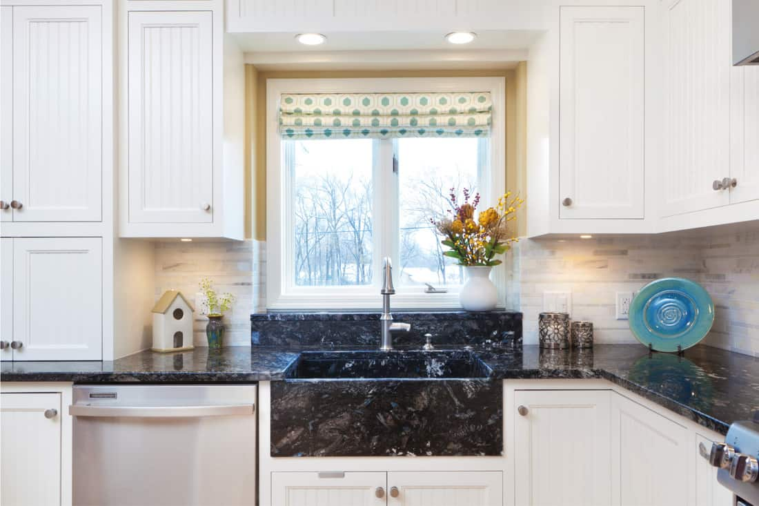 kitchen with new stainless steel appliances dish washer, granite sink and granite counter top. low kitchen window with added border
