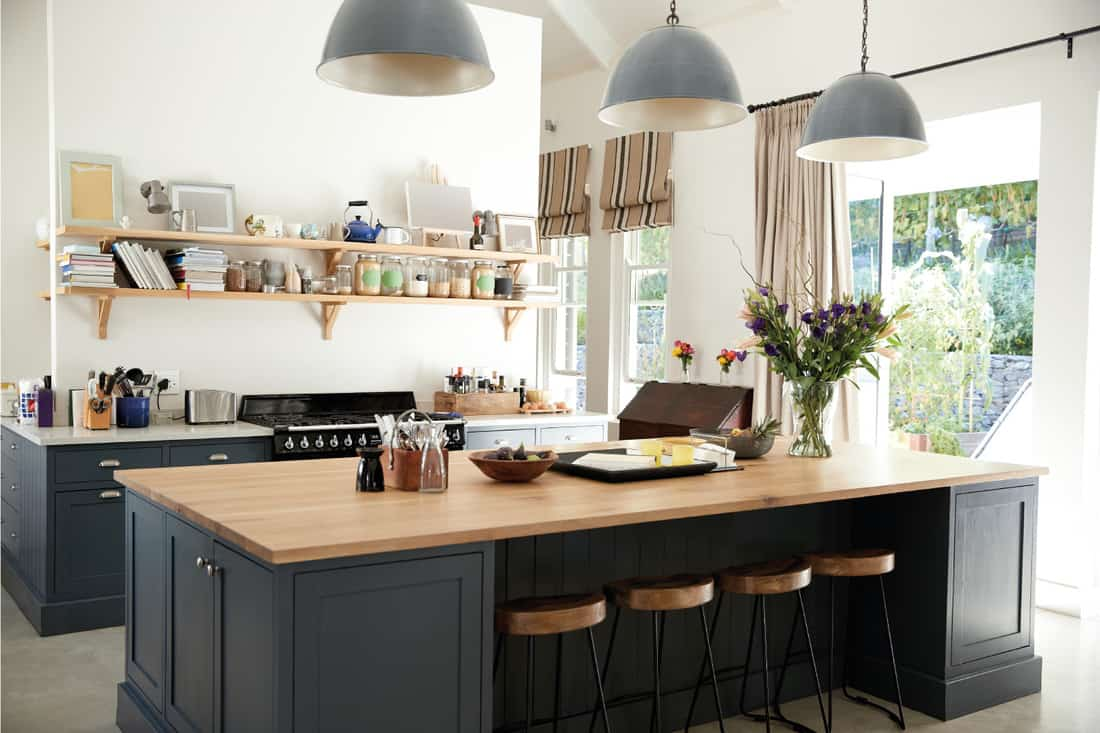 large family kitchen with island and vertical stripe window blinds