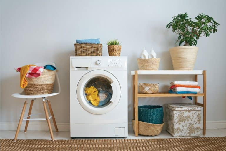laundry room with washing machine, wicker basket, brown rug. Samsung Washer Won't Drain - What To Do