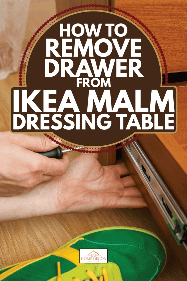 man tinkering a dressing table with a drawer with a screwdriver. How To Remove Drawer From Ikea Malm Dressing Table