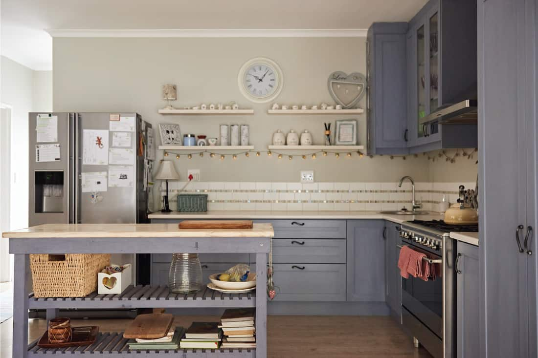 modern Grey, beige country kitchen with table and utensils