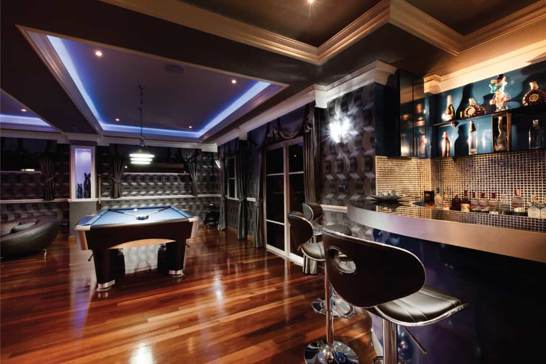 modern class Luxury game room lounge with a bar and pool table