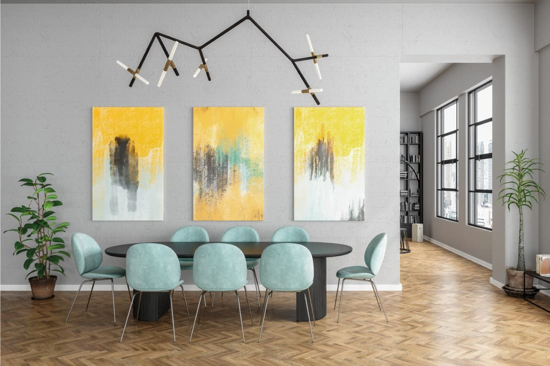 Modern dining room with abstract grace, dominant grays and blue greens