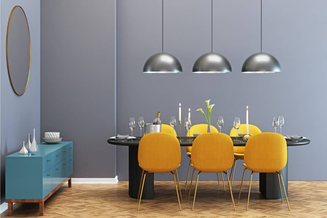 Modern dining room with color pop, theme yellow chairs, gray wall, light wood floors