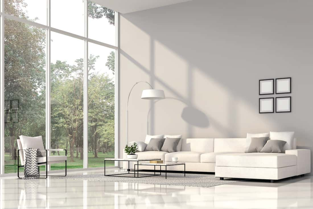 Modern living room interior with White Fabric Arm Chair, large window, white floor, grey walls