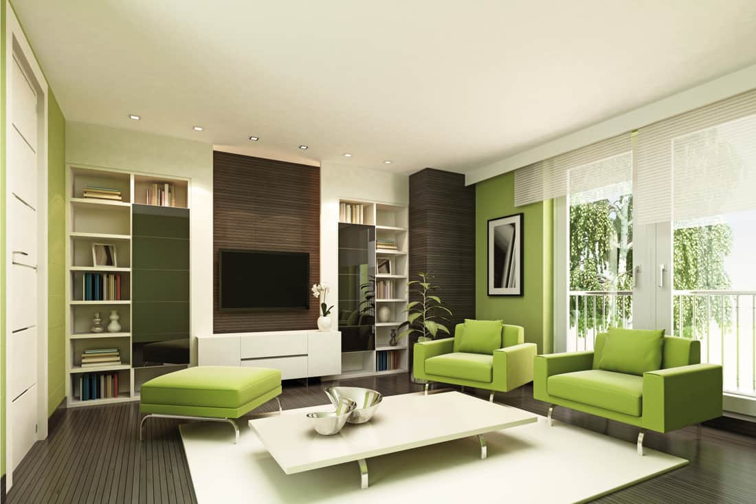 Modern living room with lime green walls and furniture, dark brown accents and bookshelves
