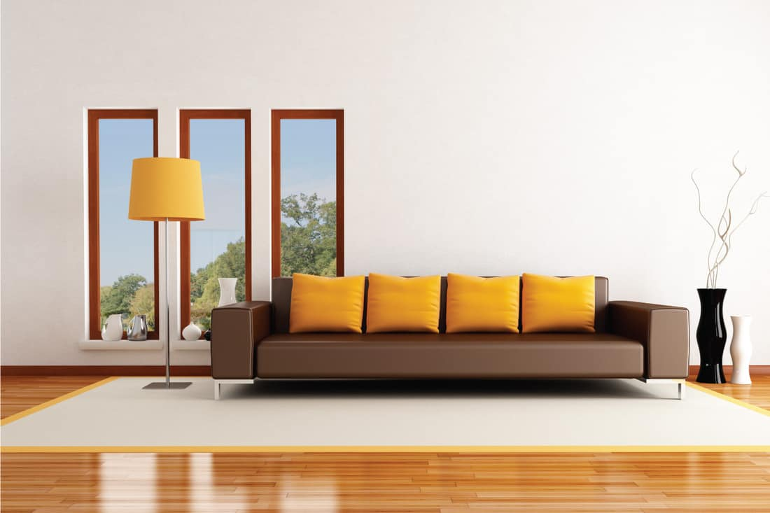 modern living room with a Pop Of Coloryellow on the throw pillows