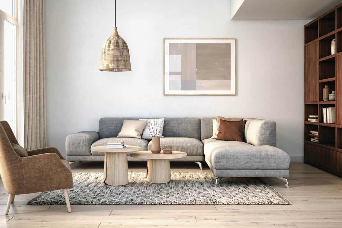 Modern Scandinavian living room with grey and beige colored furniture and wooden elements