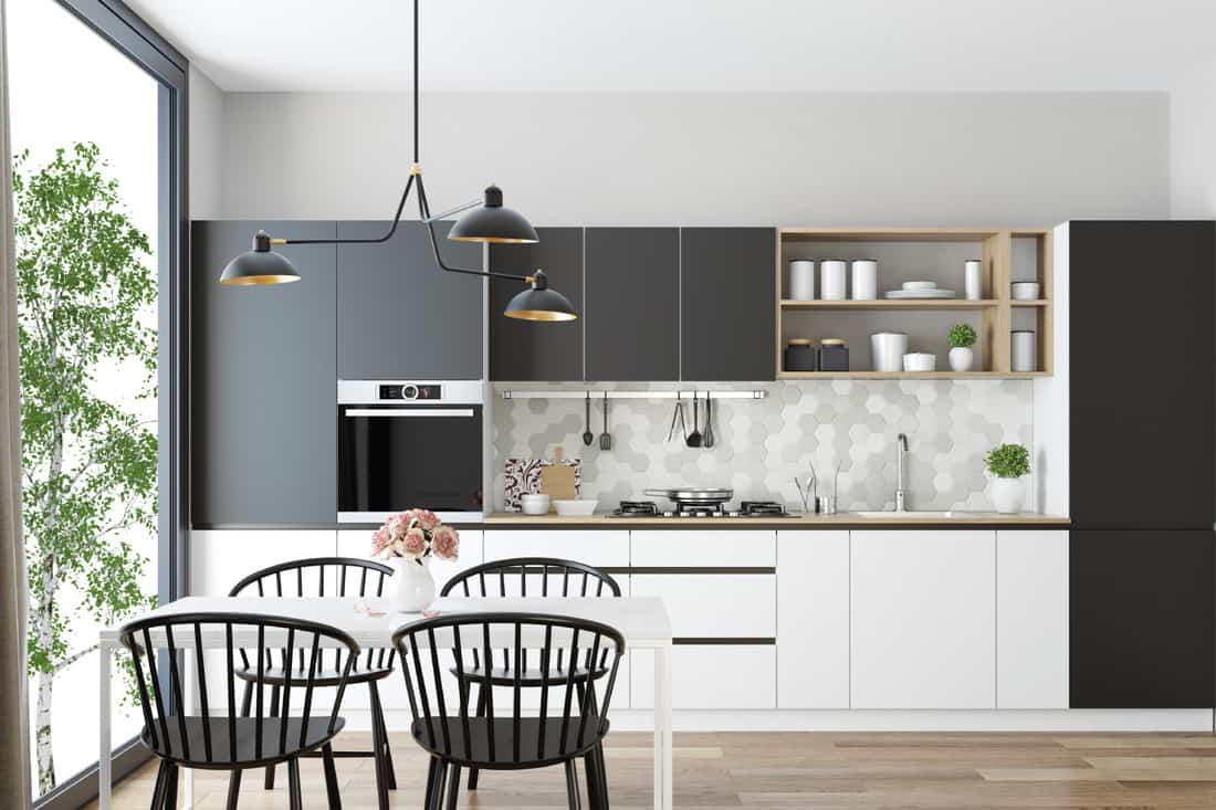 bright one wall kitchen with gray and white wooden cabinets, open light wood shelves and light gray honeycomb ceramic back-splash tiles. kitchen sink along the wall
